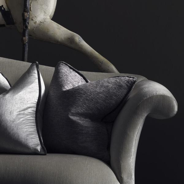 Donald_sofa_upholstered_in_Stardust_Silver_velvet_Cushions_from_L_to_R_in_Electric_Storm_Vibe_Silver_and_Insomnia_Storm