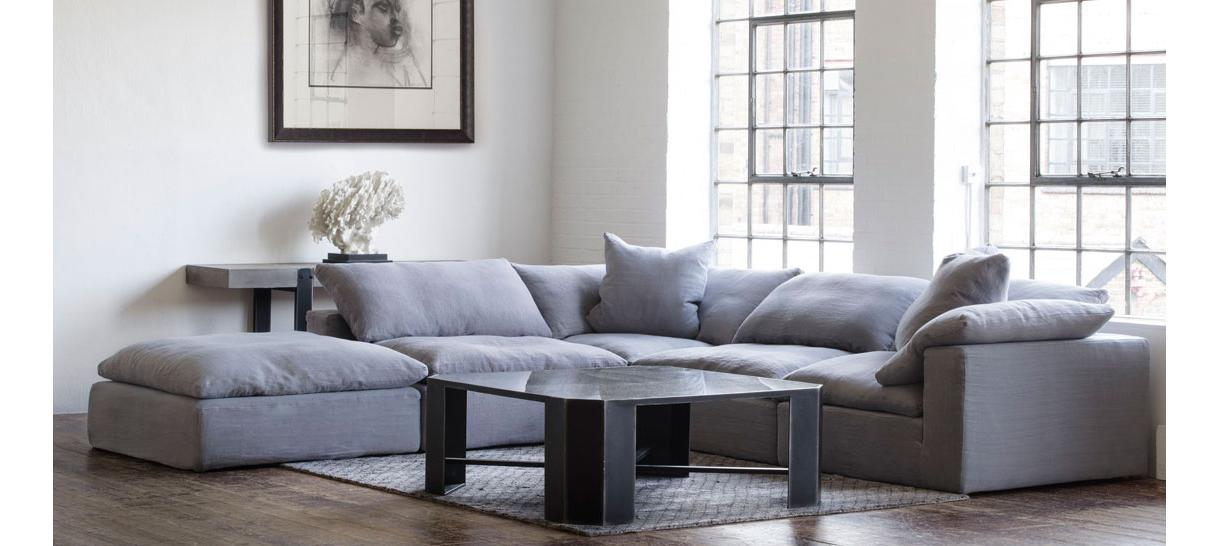 andrew_martin_sectional_sofas_truman_sectional_sofa_grey_linen_lifestyle_with_victor_coffee_table