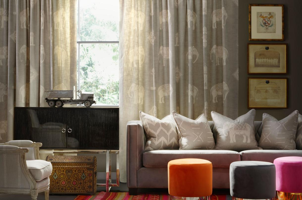 Jumbo_Stone_Fabric_Curtains_Nile_Stone_upholstered_to_antique_chair_Brooke_Cabinet_Renee_Large_Sofa_with_Togo_Stone_Kongo_Stone_and_Jumbo_Stone_Scatter_Cushions_Chandler_Stools_in_Orange_Grey_and_Pink